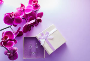 Jewelry inside a gift box with flowers